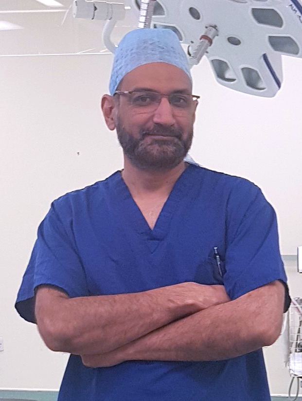 Photo of Mr Qurashi, an experienced laparoscopic and general surgeon, in theatre.